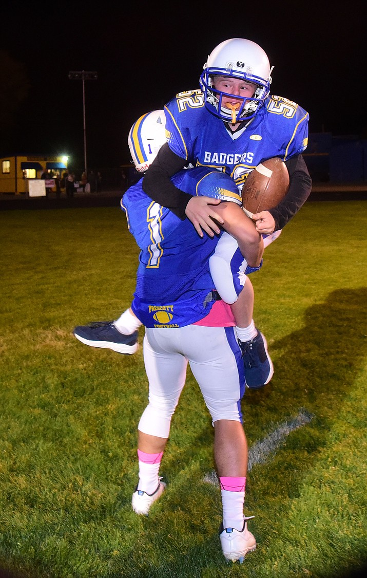 Ryan Tardibuono celebrates with Nathan Briseno (1) after scoring a touchdown before the Prescott Badgers play cross mountain rival Mingus for the region title Friday, Oct. 26, 2018 in Prescott. (Les Stukenberg/Courier)