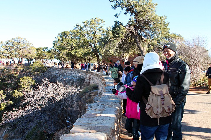 Holiday crowds at Grand Canyon National Park were consistent in spite of a partial government shutdown that has left the park largely unstaffed. Visitors were packed along the South Rim outside the El Tovar Hotel Dec. 26. (Erin Ford/WGCN)