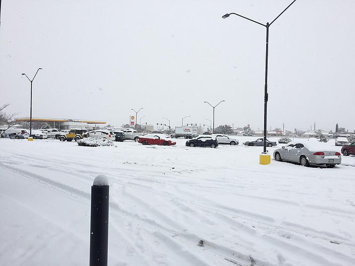 A photo of a parking lot near Eastridge Drive and Robert Road in Prescott Valley. The Prescott Valley Police Department issued a snow advisory Monday, Dec. 31, 2018, announcing several road closures in Prescott Valley. (Brian M. Bergner Jr./Courier)