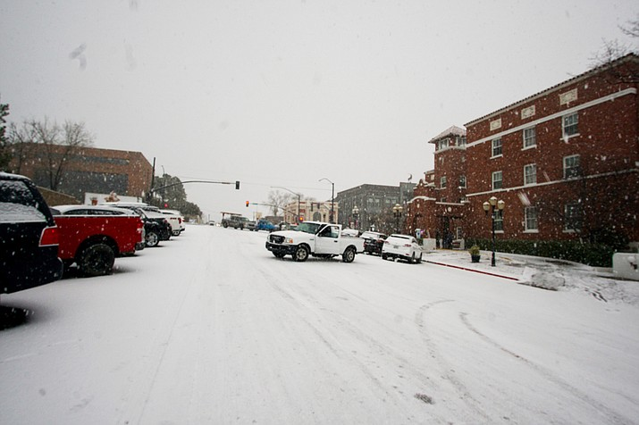 Cars remained parked in downtown Prescott after a winter storm caused several accidents and road closures Monday, Dec. 31, 2018. (Cindy Barks/Courier)