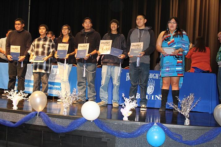 Sixteen Hopi High Jr./Sr. High School students graduated Dec. 21. Above from left: Isaac Torivio, Jalen Scott, Ferrisa Satala, Austin Masayesva, Arthur Masawytewa, Raymond Martinez and Shyla Chee. (Stan Bindell/NHO)