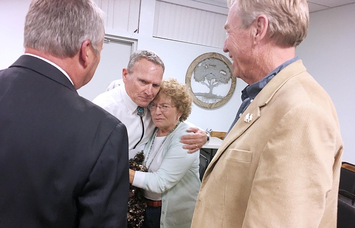 New Camp Verde council member Joe Butner hugs outgoing council member Jackie Baker, as new council member Bill LeBeau and Yavapai County District 2 Supervisor Tom Thurman look on. Baker first joined the Camp Verde council on 1999. VVN/Bill Helm