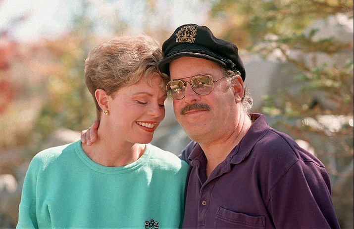 This Oct. 25, 1995, file photo shows Toni Tennille, left, and Daryl Dragon, the singing duo The Captain and Tennille, posing during an interview in at their home in Washoe Valley, south of Reno, Nev. Dragon died early Wednesday, Jan. 2, 2019, in at a hospice in Prescott, Arizona. Spokesman Harlan Boll said he was 76 and died of renal failure. His former wife and musical partner, Toni Tennille, was by his side. (David B. Parker/AP, File)