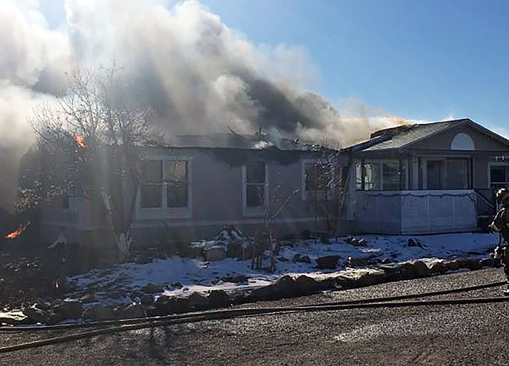 Mayer Fire personnel and YCSO deputies on the scene of a residential fire in the 15400 block of Cayuse Lane off Rolling Ridge Drive in Cordes Lakes on Wednesday afternoon, Jan. 2, 2019. (YCSO photo).