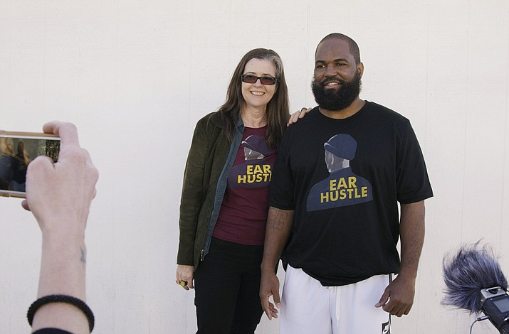 Nigel Poor, left, and Earlonne Woods stand outside San Quentin State Prison on Woods' release day. (Kesten Migdal/PRX via AP)