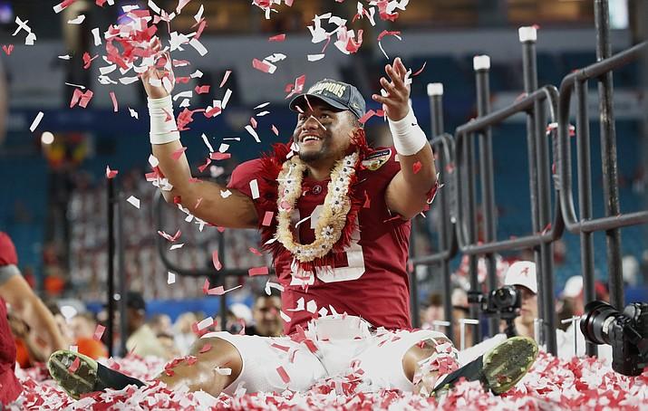 Alabama quarterback Tua Tagovailoa is throws confetti in the air after winning the Orange Bowl NCAA college football game against Oklahoma, Sunday, Dec. 30, 2018, in Miami Gardens, Fla. Alabama defeated Oklahoma 45-34. (Wilfredo Lee/AP)