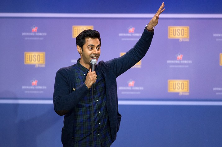 "Hasan Minhaj performs at an USO show in 2016. Netflix is facing criticism for pulling an episode from viewing in Saudi Arabia of Minhaj's ""Patriot Act"" that lambasted Saudi Crown Prince Mohammed bin Salman over the killing of writer Jamal Khashoggi and the Saudi-led war in Yemen. (Department of Defense News photo by EJ Hersom)"