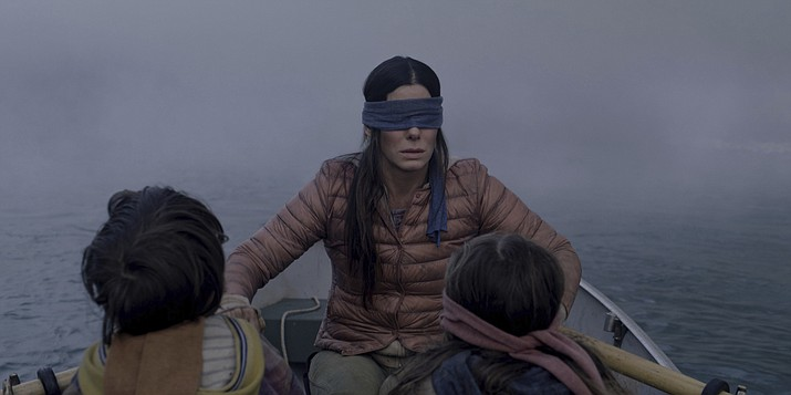 """This file image released by Netflix shows Sandra Bullock in a scene from the film, """"Bird Box."""" Netflix lifted the usually tightly sealed lid on its viewership numbers in a recent tweet that disclosed 45 million subscriber accounts had watched the thriller, """"Bird Box,"""" during its first seven days on the service. That made the film the biggest first-week success of any movie made so far for Netflix's 12-year-old streaming service. (Merrick Morton/Netflix via AP, File)"""