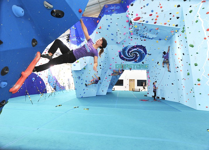 Instructors Christina Arrington, Dennis Taylor, Sam Boge, Emily Ahrendt and Gabriel Kerbs spend some time on various walls at Gripstone in Prescott in July. The climbing, yoga and cafe location opened, July 21, 2018. (Les Stukenberg/Courier)