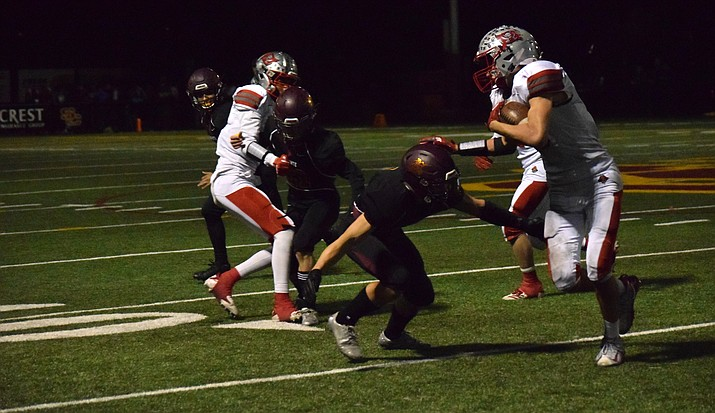 Mingus' Chaz Taylor stiff arms a Salpointe Catholic tackler during the state quarter-finals in Tucson on Nov. 9. VVN/James Kelley