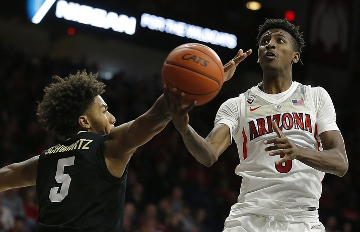 Arizona guard Dylan Smith drives past Colorado guard D'Shawn Schwartz (5) during the second half of an NCAA college basketball game Thursday, Jan. 3, 2019, in Tucson, Ariz. Arizona defeated Colorado 64-56. (Rick Scuteri/AP)