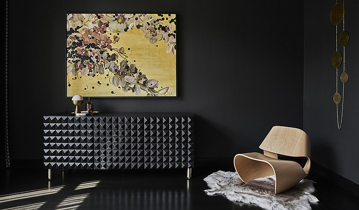 """This photo shows how Studio Gild painted the walls of this Chicago home in Benjamin Moore's Midnight. """"We wanted to create a space that's calming and cozy,"""" says Kristen Ekeland. A black sideboard from SABIN adds depth, texture and drama. (Mike Schwartz/Studio Gild via AP)"""