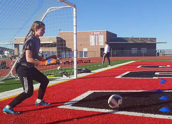 Bears girls soccer goal keeper Delaney Johnson, one of Bradshaw Mountain's three co-captains, practices a defensive drill during practice on Friday, Jan. 4, at Bob Pavlich Field in Prescott Valley. Johnson is one of the key pieces in a Bears program that is blossoming under coach John Sterling. (Doug Cook/Courier)