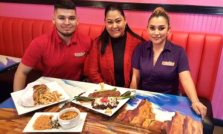Offering several signature dishes are David, Isa and Wendy Jimenez-Sanchez, the family owners of Tortas de Fuego.
