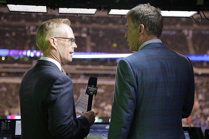 """This Oct. 11, 2018, file photo shows Troy Aikman, right, and Joe Buck working before an NFL football game between the New York Giants and the Philadelphia Eagles  in East Rutherford, N.J. """"I remember opening weekend when I got home I had a couple college buddies that were raving about the pregame show and how great and fun it was with everyone,"""" said Aikman, who was Cowboys quarterback in 1994 before joining the network seven years later. """"It was refreshing, new and unique, and that set the tone for the network.""""(Frank Franklin II/AP, file)"""