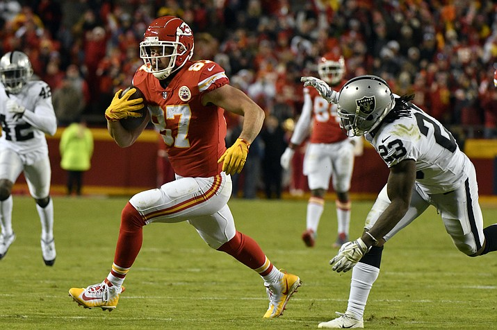 Kansas City Chiefs tight end Travis Kelce (87) carries the ball past Oakland Raiders cornerback Nick Nelson (23) during the second half of an NFL football game in Kansas City, Mo., Sunday, Dec. 30, 2018. Travis Kelce surpassed Rob Gronkowski for the most receiving yards by a tight end in a single season in NFL history. (Ed Zurga/AP)