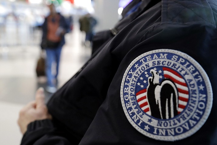 In this Dec. 25, 2018 file photo, a TSA worker works at O'Hare International Airport in Chicago. The federal agency tasked with guaranteeing U.S. airport security is acknowledging an increase in the number of its employees calling off work during the partial government shutdown. (Nam Y. Huh/AP)