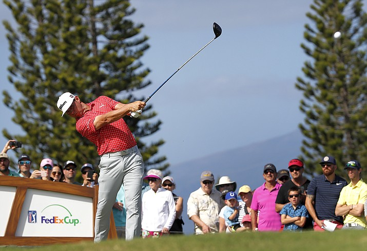 Gary Woodland plays his shot from the third tee during the third round of the Tournament of Champions golf event, Saturday, Jan. 5, 2019, at Kapalua Plantation Course in Kapalua, Hawaii. (Matt York/AP)
