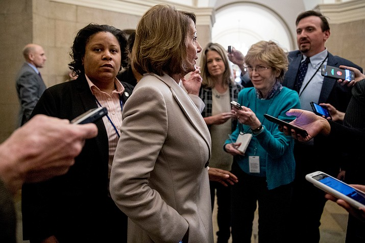 House Speaker Nancy Pelosi of Calif. speaks to reporters as she arrives back at the Capitol building after meeting with President Donald Trump about border security in the Situation Room of the White House in Washington, Friday. (Andrew Harnik/AP)