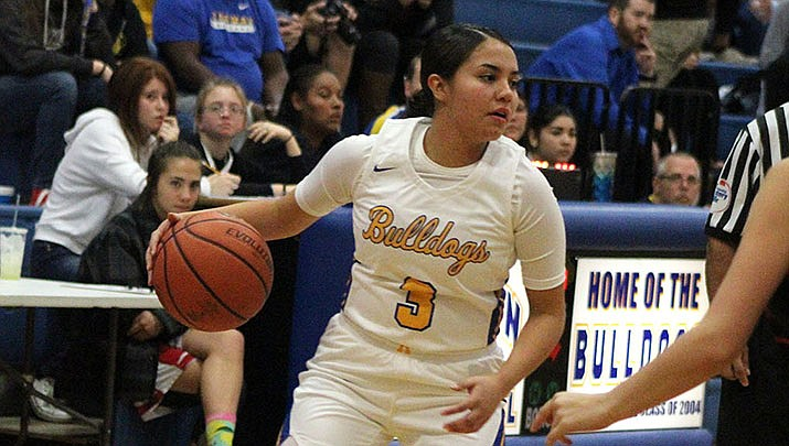 Sukwana Quasula led Kingman High with 15 points Friday in a 38-22 victory over Northwest Christian. It was the Lady Bulldogs' seventh straight win. (Daily Miner file photo)