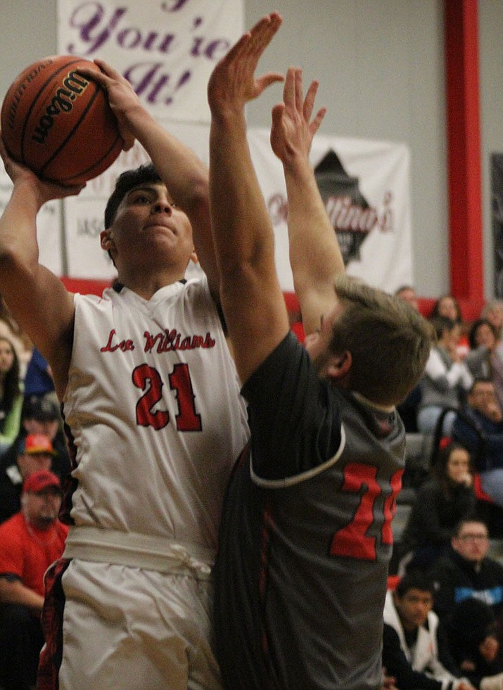 Aaron Santos scored a game-high 22 points Friday night in a 85-29 win over River Valley. (Photo by Beau Bearden/Daily Miner)