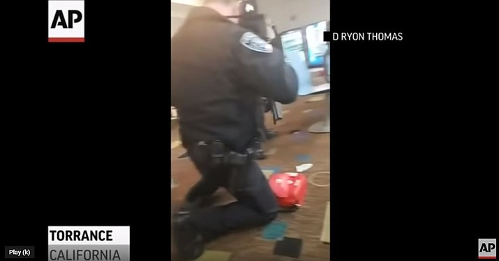 """The Torrance Police Department responded to calls of """"shots fired"""" at the Gable House Bowl shortly before midnight. (Photo capture via AP video)"""