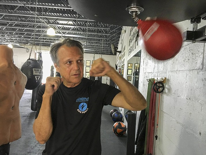 Steve Shepherd, a world champion kickboxer, works out Thursday, Jan. 3, 2019, in West Palm Beach, Fla. Shepherd was limping to his car last week, a pulled muscle impairing his stride, when a mugger hit him in the head with a bottle and demanded his cellphone. Shepherd threw a right cross to the attacker's head, and then smashed a hook to his ribs, crumpling him.(Catie Wegman/Palm Beach Post via AP)