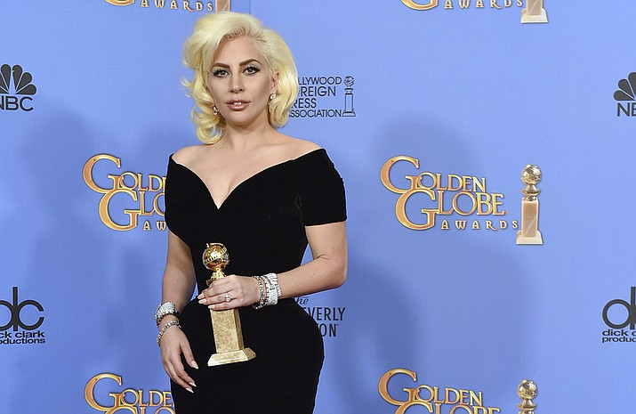 "In this Jan. 20, 2016 file photo, Lady Gaga poses in the press room with the award for best performance by an actress in a limited series or a motion picture made for TV for ""American Horror Story: Hotel"" at the 73rd annual Golden Globe Awards at the Beverly Hilton Hotel in Beverly Hills, Calif. Lady Gaga is poised to win not just one but two awards when the 76th annual Golden Globes get under way Sunday, Jan. 6, 2019. (Photo by Jordan Strauss/Invision/AP)"