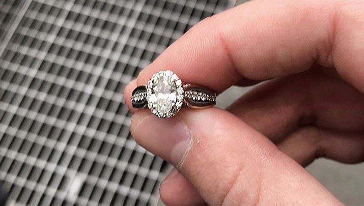 For the second time in two months police officers in New York have recovered another engagement ring lost in a sewer grate. (Photo courtesy NYPD Midtown North)