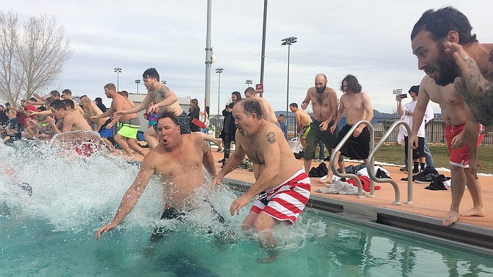 Polar Bears take the plunge at the 14th annual Polar Bear Splash at Mountain Valley Splash Saturday, Jan. 5. (Jason Wheeler/Courier)