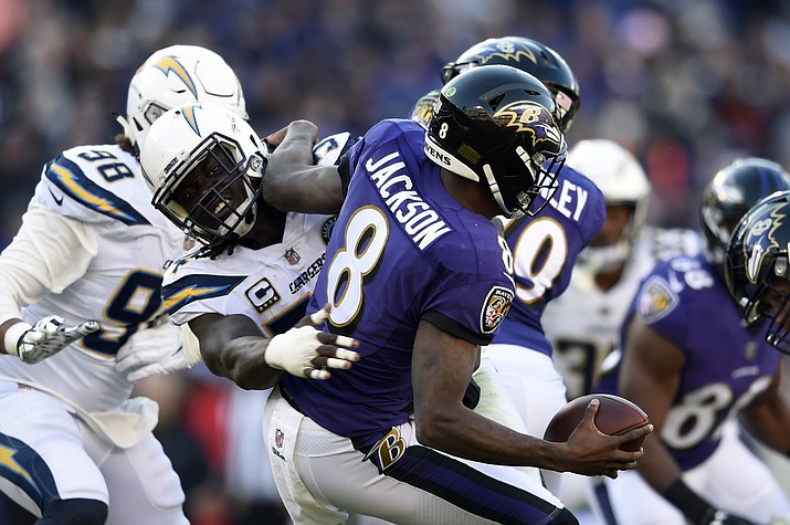Baltimore Ravens quarterback Lamar Jackson (8) is sacked by Los Angeles Chargers defensive end Melvin Ingram in the second half of an NFL wild card playoff game Sunday, Jan. 6, 2019, in Baltimore. (Gail Burton/AP)