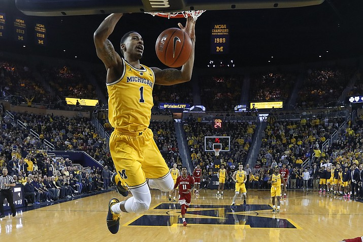 Michigan guard Charles Matthews dunks in the first half of an NCAA college basketball game against Indiana in Ann Arbor, Mich., Sunday, Jan. 6, 2019. (Paul Sancya/AP)