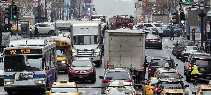 Traffic makes it's way across 42nd Street in New York City. (Mary Altaffer/AP, File)
