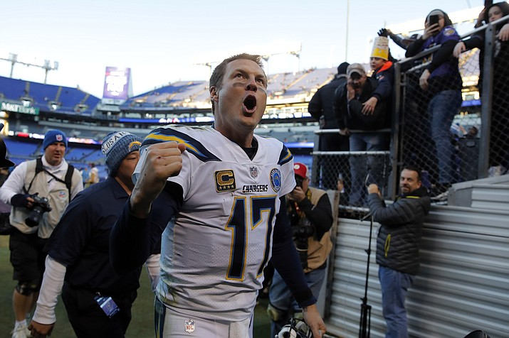 Los Angeles Chargers quarterback Philip Rivers celebates as he walks off the field after an NFL wild card playoff football game against the Baltimore Ravens, Sunday, Jan. 6, 2019, in Baltimore. Los Angeles won 23-17. (Carolyn Kaster/AP)