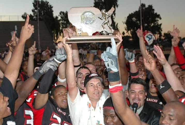 Joe Kersting holds up a championship trophy with Glendale Community College. Kersting will be the offensive coordinator for the Prescott football program in 2018. (Joe Kersting/Courtesy)