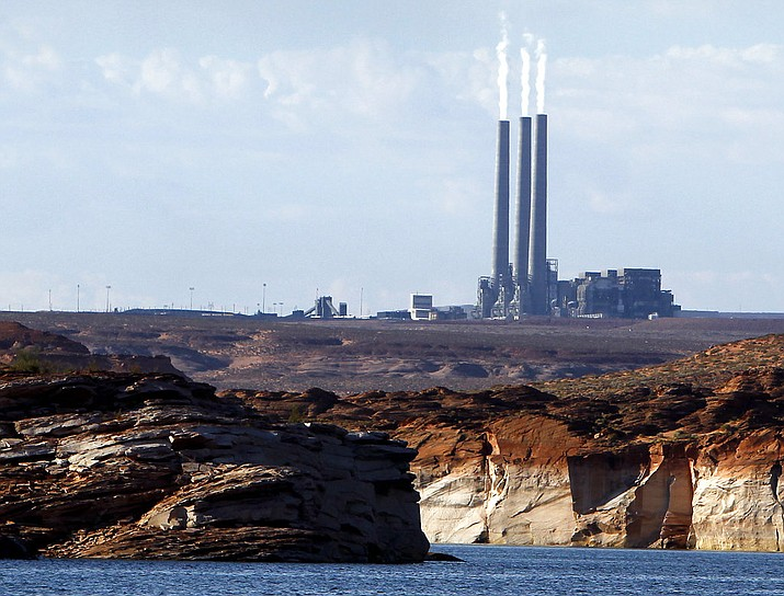 This 2011 file photo shows the main plant facility at the Navajo Generating Station northeast of Grand Canyon National Park as seen from Lake Powell in Page. (Ross D. Franklin/AP, File)