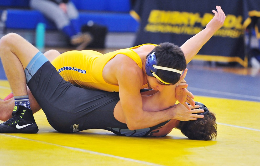 Embry Riddle's Carlos Apodaca pins Wyatt Kesler as the Eagles take on the Western Pacific Knights in a wrestling dual Monday afternoon in Prescott. (Les Stukenberg/Courier).