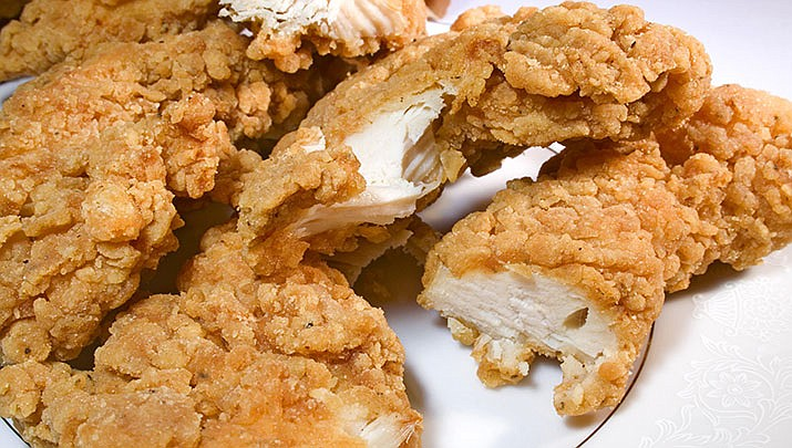 An 18-wheeler crashed on Alabama 35 on Sunday, spilling boxes of chicken tenders in Cherokee County near the Georgia line. Motorists began stopping to pick up the food, which authorities say created a traffic hazard. (Stock art)