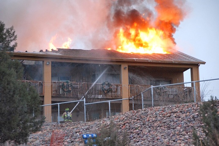 Firefighters battle an attic fire along Grey Gos Road in Chino Valley Saturday, Jan. 5.