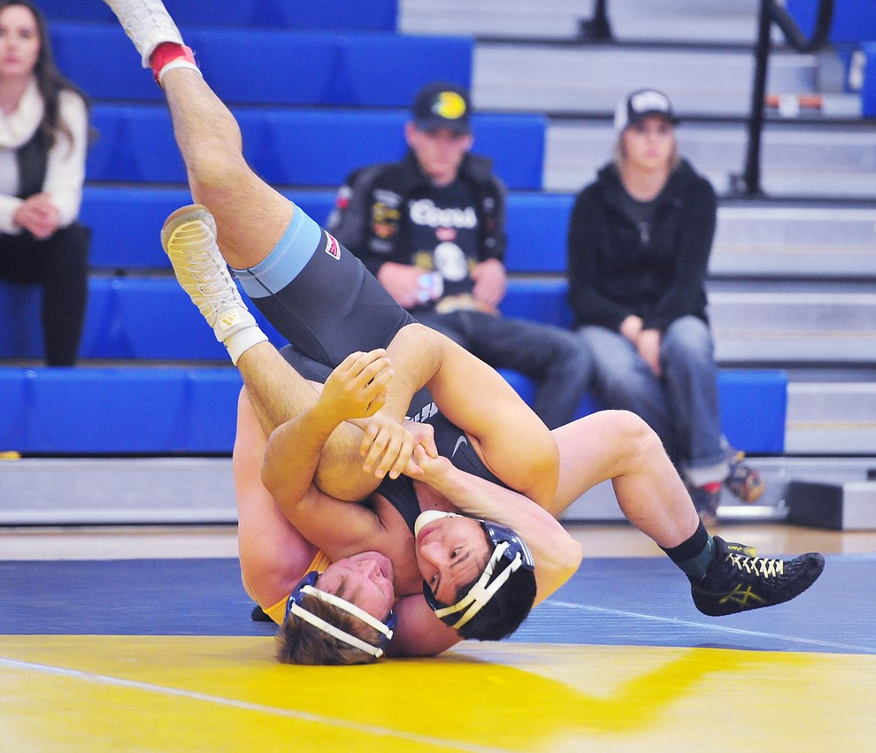 Embry Riddle's Eli Mason, left, pins Alvaro Venegas as the Eagles take on the Western Pacific Knights in a wrestling dual Monday afternoon in Prescott. (Les Stukenberg/Courier).