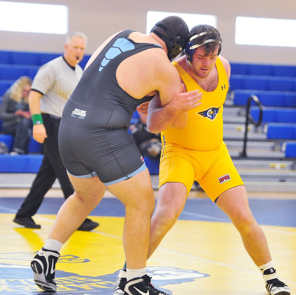 Embry Riddle's Garette Branson, right, wrestles Cortez Rodelo as the Eagles take on the Western Pacific Knights in a wrestling dual Monday afternoon in Prescott. (Les Stukenberg/Courier).