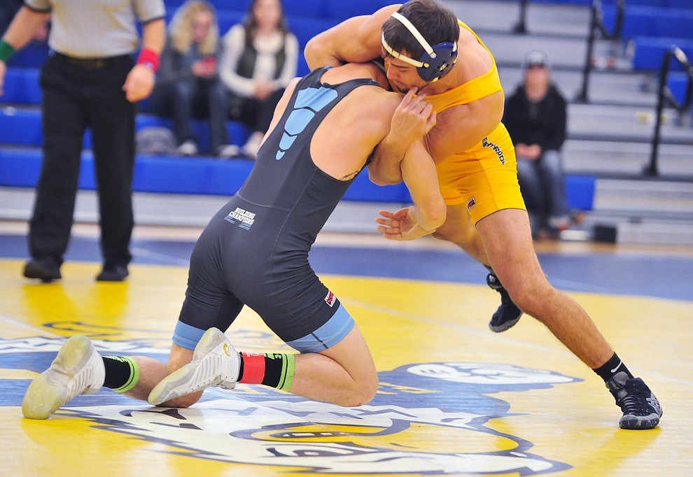 Embry Riddle's James Williams, right, wrestles Chas Peterson as the Eagles take on the Western Pacific Knights in a wrestling dual Monday afternoon in Prescott. (Les Stukenberg/Courier).