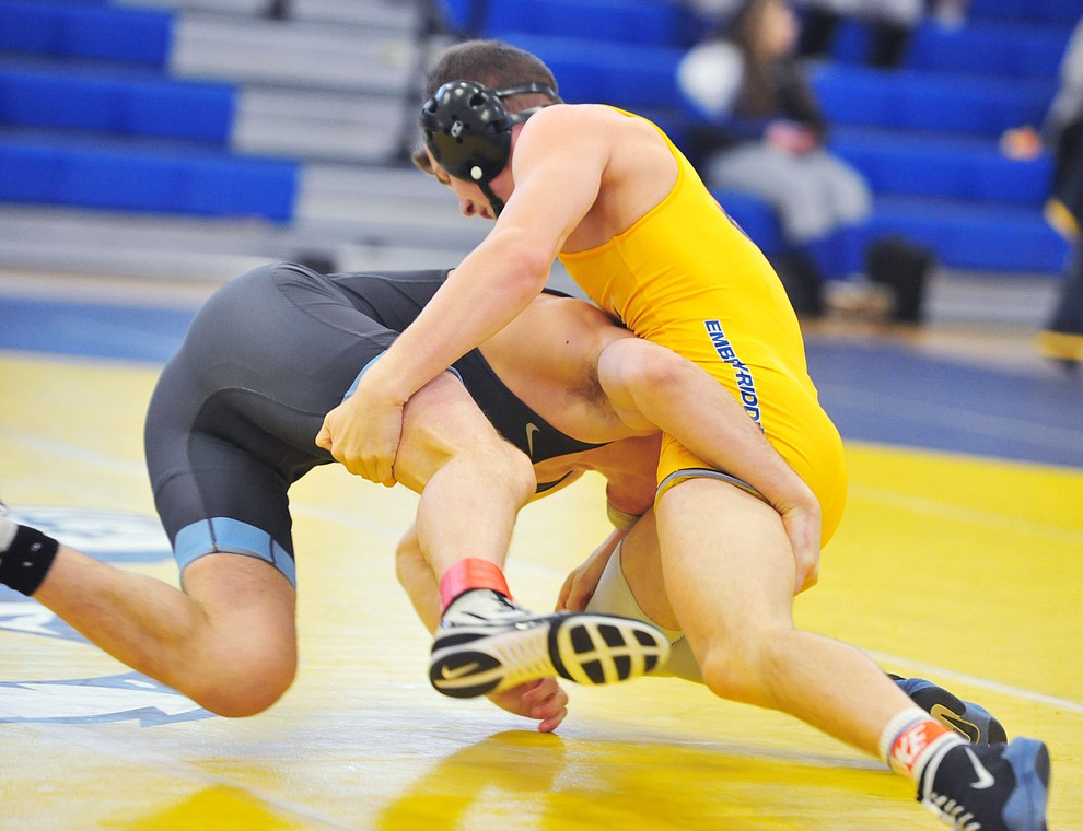 Embry Riddle's Jayce Cunha, right, wrestles Lucas Higginbotham as the Eagles take on the Western Pacific Knights in a wrestling dual Monday afternoon in Prescott. (Les Stukenberg/Courier).
