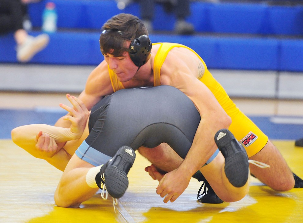 Embry Riddle's Kody Davis, top, wrestles Mark Meier as the Eagles take on the Western Pacific Knights in a wrestling dual Monday afternoon in Prescott. (Les Stukenberg/Courier).