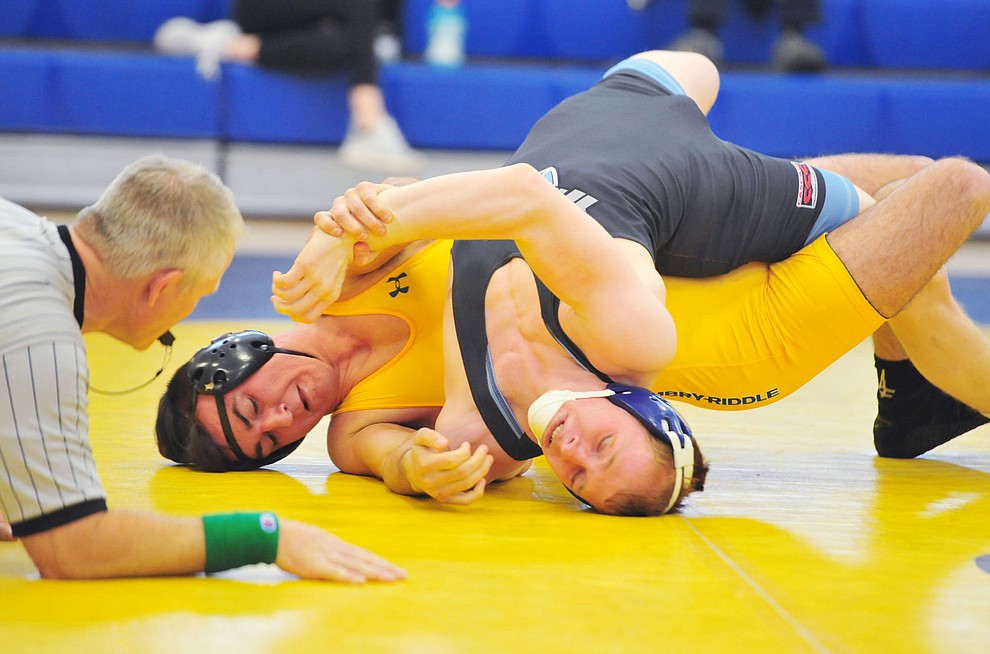 Embry Riddle's Kody Davis, left, wrestles Mark Meier as the Eagles take on the Western Pacific Knights in a wrestling dual Monday afternoon in Prescott. (Les Stukenberg/Courier).