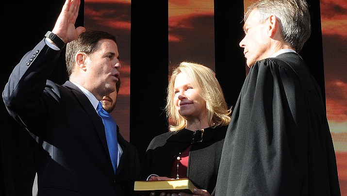 With wife Angela at his side, Gov. Doug Ducey is sworn in Monday for a second term by Arizona Chief Justice Scott Bales (Capitol Media Services photo by Howard Fischer)