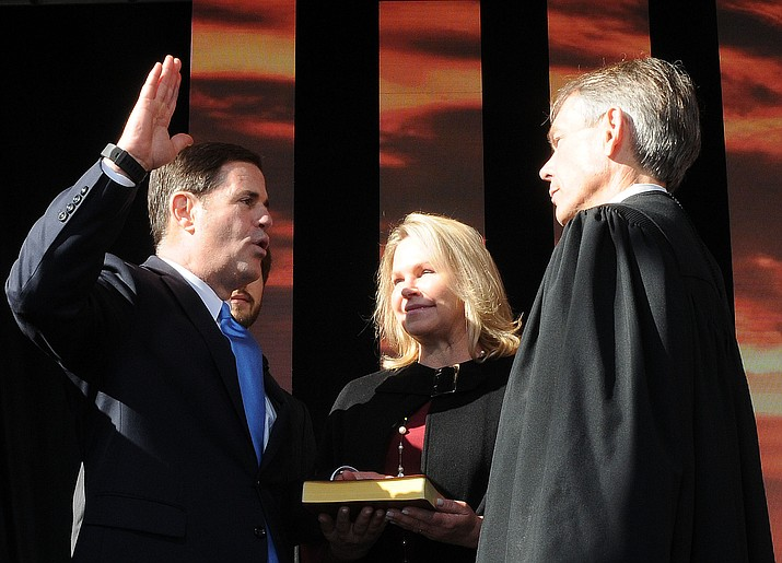 With wife Angela at his side, Gov. Doug Ducey is sworn in Monday for a second term by Arizona Chief Justice Scott Bales. (Howard Fischer/Capitol Media Services)