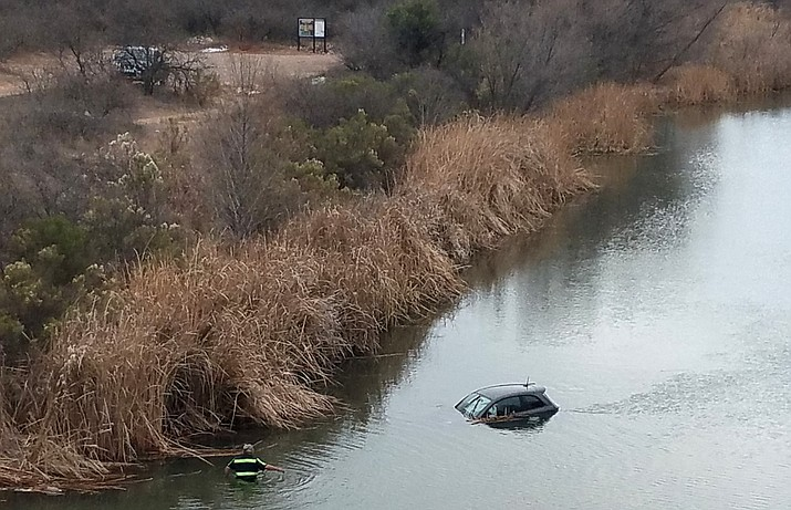 Saturday at about 3 p.m., Clarkdale police were alerted to a vehicle partially submerged in the Verde River at the Tuzigoot River Access Point. Photo courtesy of Clarkdale Police Dept.