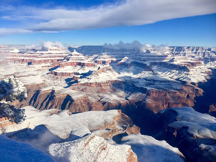 The South Rim (right) was also blanketed in snow, even far down into the inner canyon.  (Photo/Michael Quinn, NPS)