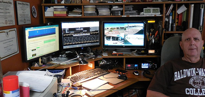 Ray Kolman has four monitors, a scanner and two ham radios in his office. He conducts Radio Net practice every Sunday for the Prescott Valley community. (Courtesy/Ray Kolman)